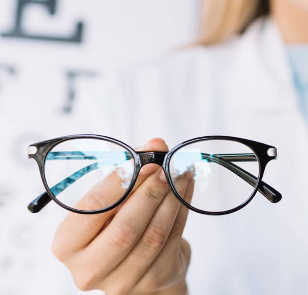 Woman optician presenting reading glasses