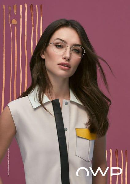 Woman optician presenting reading glasses